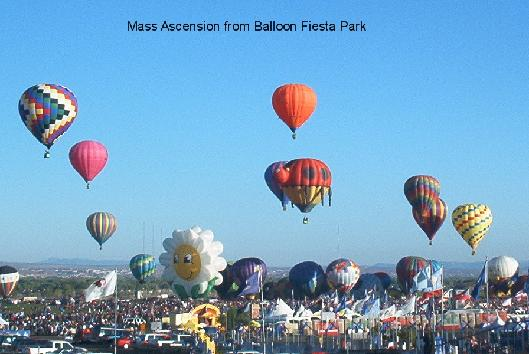 Hot air balloons of all shapes fill the sky as the fly over Albuquerque during the Albuquerque International Balloon Fiesta